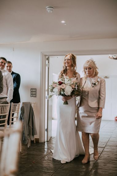Bridal Entrance with Mother of The Bride | Bride in Madison James Bridal Gown | Millbridge Court, Surrey Wedding with DIY Decor, Foliage & Giant Balloons | Nataly J Photography