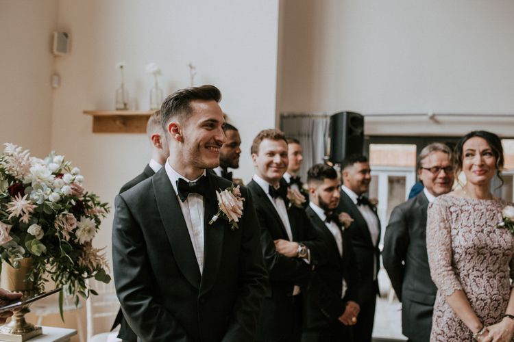 Groom at the Altar in Black Tie Suit | Millbridge Court, Surrey Wedding with DIY Decor, Foliage & Giant Balloons | Nataly J Photography