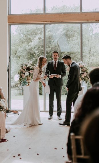 Wedding Ceremony Vows | Bride in Madison James Bridal Gown | Groom in Tuxedo | Millbridge Court, Surrey Wedding with DIY Decor, Foliage & Giant Balloons | Nataly J Photography