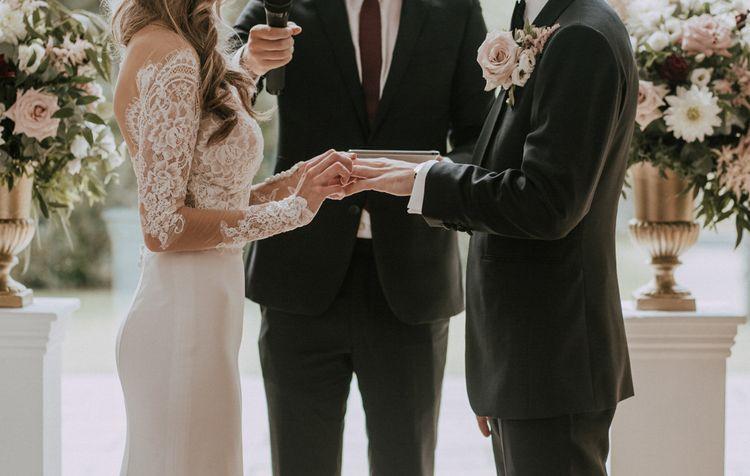 Wedding Ceremony | Bride in Madison James Bridal Gown | Groom in Tuxedo | Millbridge Court, Surrey Wedding with DIY Decor, Foliage & Giant Balloons | Nataly J Photography