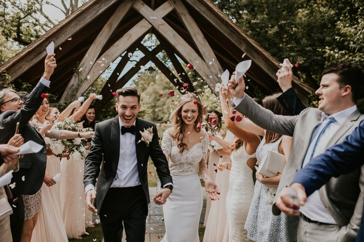 Confetti Moment | Bride in Madison James Bridal Gown | Groom in Tuxedo | Millbridge Court, Surrey Wedding with DIY Decor, Foliage & Giant Balloons | Nataly J Photography