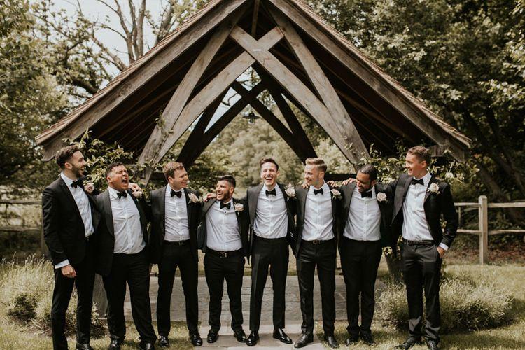 Groomsmen in Black Tuxedos | Millbridge Court, Surrey Wedding with DIY Decor, Foliage & Giant Balloons | Nataly J Photography