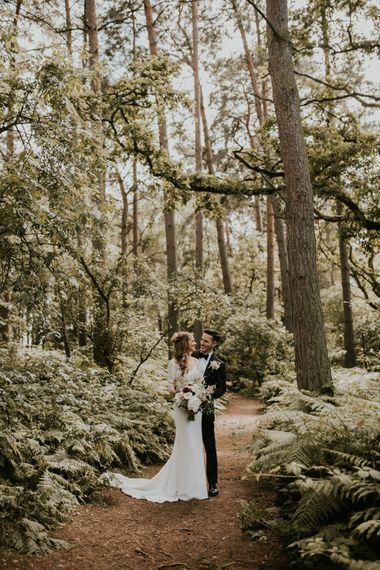 Woodland Portrait | Bride in Madison James Bridal Gown | Groom in Tuxedo | Millbridge Court, Surrey Wedding with DIY Decor, Foliage & Giant Balloons | Nataly J Photography