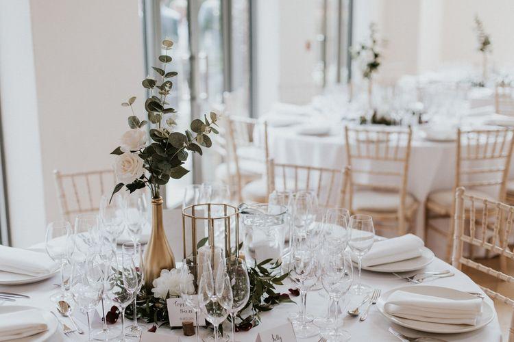 Gold Vase Centrepiece with White & Green Flower Stems | Millbridge Court, Surrey Wedding with DIY Decor, Foliage & Giant Balloons | Nataly J Photography