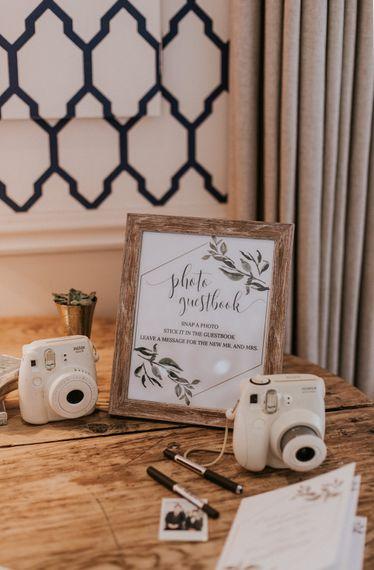 Polaroid Guest Book Station | Millbridge Court, Surrey Wedding with DIY Decor, Foliage & Giant Balloons | Nataly J Photography