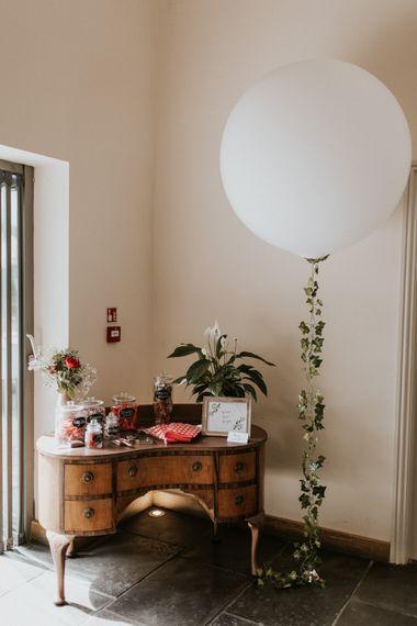Vintage Dresser Sweet Station | Giant Balloon with Vine Decor | Wedding Decor | Millbridge Court, Surrey Wedding with DIY Decor, Foliage & Giant Balloons | Nataly J Photography
