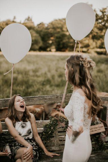 Bride in Madison James Bridal Gown | Millbridge Court, Surrey Wedding with DIY Decor, Foliage & Giant Balloons | Nataly J Photography