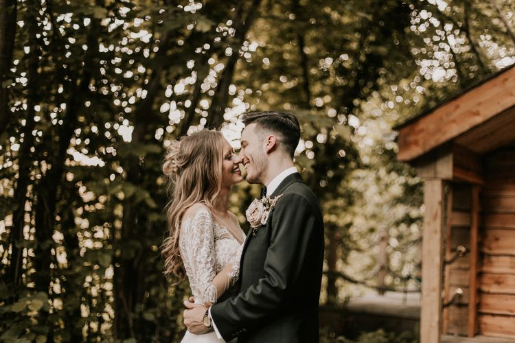 Bride in Madison James Bridal Gown | Groom in Tuxedo | Millbridge Court, Surrey Wedding with DIY Decor, Foliage & Giant Balloons | Nataly J Photography