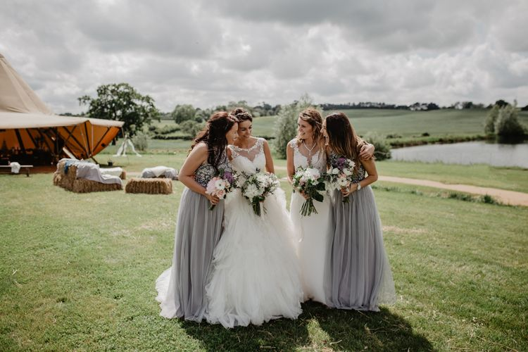 Bridesmaids In Grey Dresses // Outdoor Tipi Wedding At Tip Top Venues With Images From Elena Popa Photography Grazing Board Wedding Food And Brides In Wed 2 B Dresses