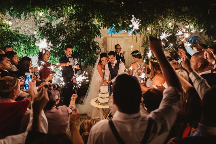 Cake Cutting And Sparklers // French Destination Wedding Bordeaux  Marry Me In France Suzanne Neville Bride Darek Smietana Photography