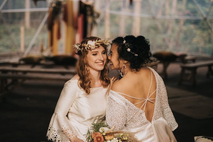 Brides in Strappy Back Dress and Laser Cut Bell Sleeve Wedding Dress