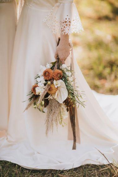 Bride Holding a Boho Wedding Bouquet