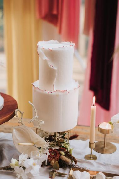 Elegant Two Tier Iced Wedding Cake with Rough Edge Detail