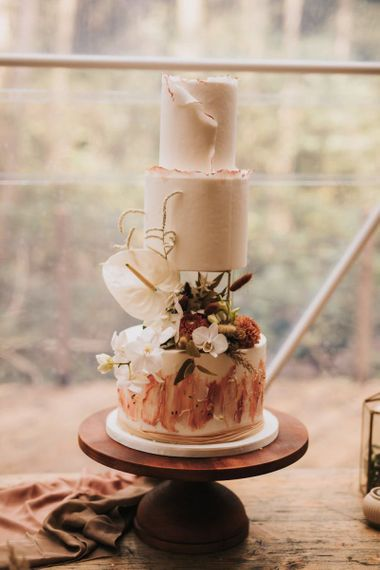 Bohemian Wedding Cake on Wooden Cake Stand in Geometric Dome