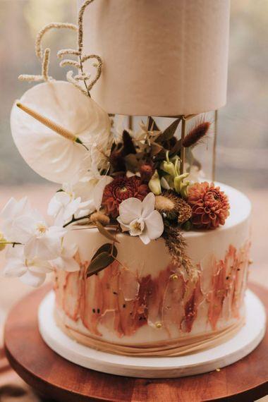 White Anthurium's and Pompom Dahlia Wedding Cake Decor
