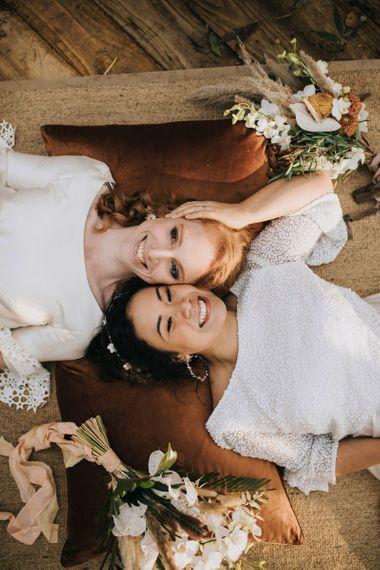 Same Sex Wedding Couple Laying on the Floor