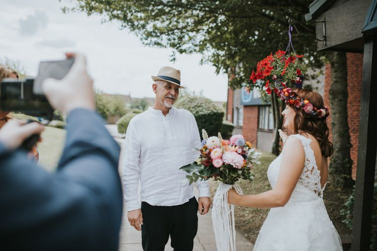 Father of the Bride First Look with Bride in Lace Wedding Dress and Colourful Flower Crown