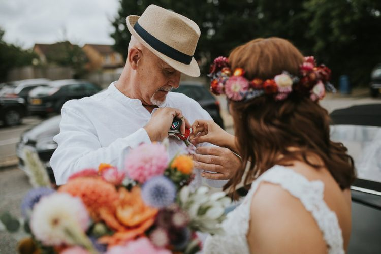 Father of the Bride in Fedora Hat Putting on a Buttonhole