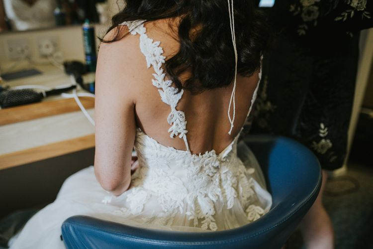 Bride Getting Ready in Lace Wedding with Straps