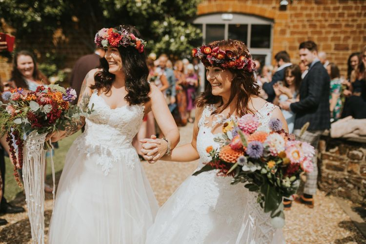 Same Sex Wedding Confetti Moment with Two Brides in Lace Wedding Dress
