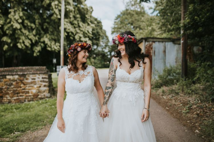 Same Sex Brides in Lace Wedding Dresses and Colourful Flower Crowns