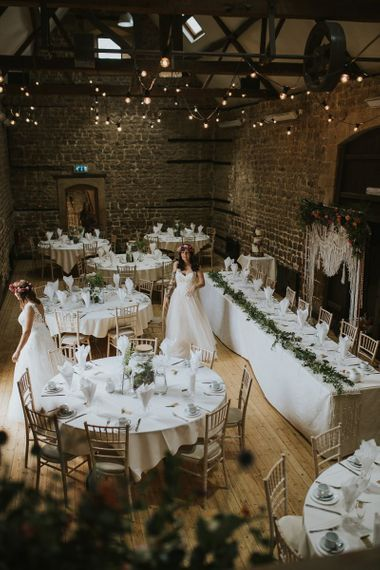 Reception at The Barns at Hunsbury Hill in Northamptonshire with Festoon Lights and Macrame Top Table Backdrop