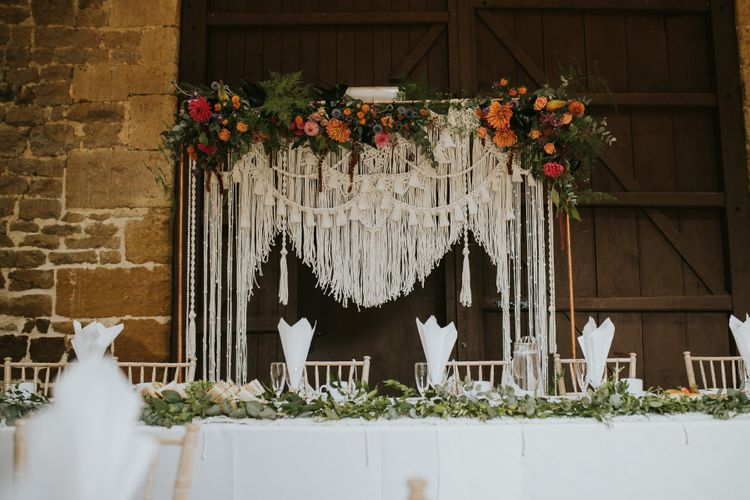 Homemade Macrame Backdrop on Copper Frame with Colourful Wedding Flowers