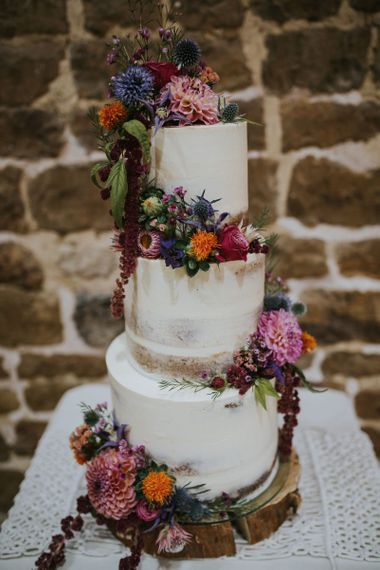 Semi Naked Wedding Cake on a Tree Slice with Colourful Wedding Flowers