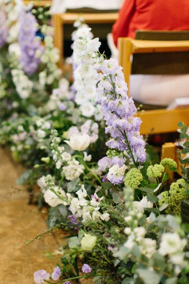 Lilac and white floral aisle runner   Papakata Sperry Tent Wedding at family home   Sassi Holford Dress with added ivory Ostrich feathers to veil   Manolo Blahnik shoes   Images by Melissa Beattie