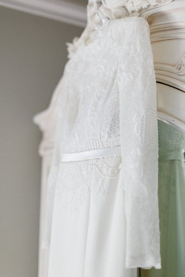 Lace dress detail   Papakata Sperry Tent Wedding at family home   Sassi Holford Dress with added ivory Ostrich feathers to veil   Manolo Blahnik shoes   Images by Melissa Beattie