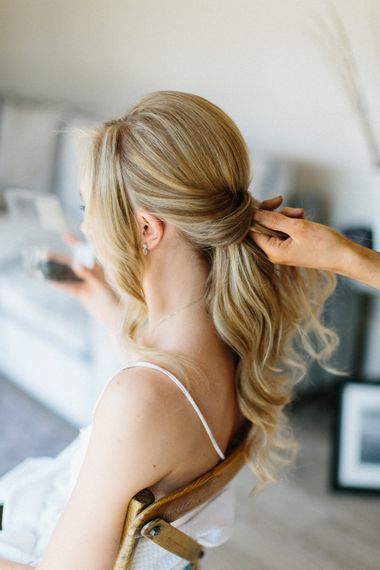 Loose romantic updo for Bride   Papakata Sperry Tent Wedding at family home   Sassi Holford Dress with added ivory Ostrich feathers to veil   Manolo Blahnik shoes   Images by Melissa Beattie