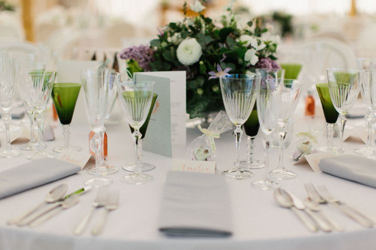 White, green and lilac flowers   Papakata Sperry Tent Wedding at family home   Sassi Holford Dress with added ivory Ostrich feathers to veil   Manolo Blahnik shoes   Images by Melissa Beattie