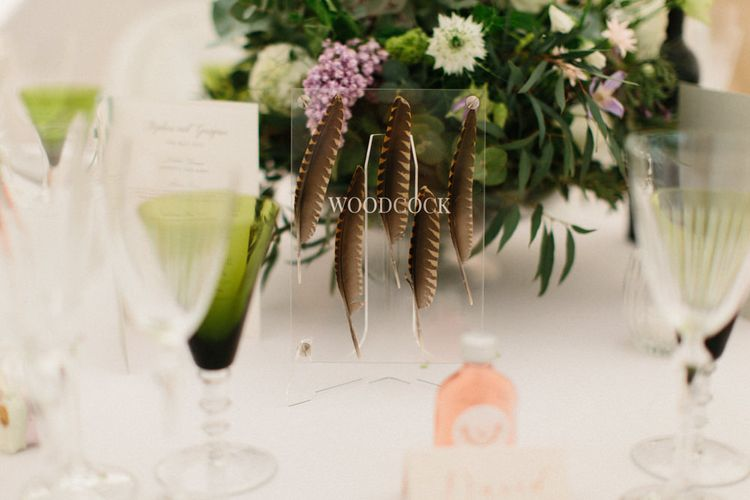 Feathers placed in acrylic table names   Papakata Sperry Tent Wedding at family home   Sassi Holford Dress with added ivory Ostrich feathers to veil   Manolo Blahnik shoes   Images by Melissa Beattie