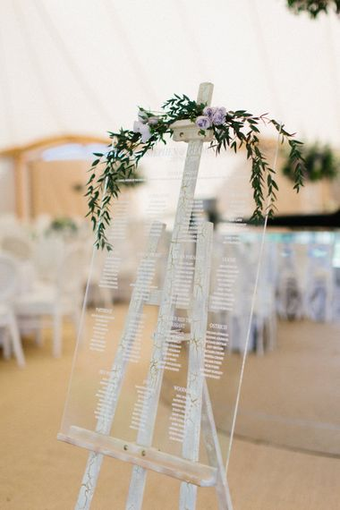 Acrylic table plan   Papakata Sperry Tent Wedding at family home   Sassi Holford Dress with added ivory Ostrich feathers to veil   Manolo Blahnik shoes   Images by Melissa Beattie