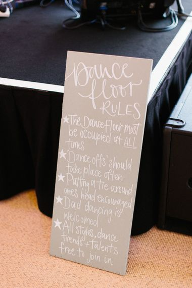 Calligraphy signage   Dance floor rules   Papakata Sperry Tent Wedding at family home   Sassi Holford Dress with added ivory Ostrich feathers to veil   Manolo Blahnik shoes   Images by Melissa Beattie