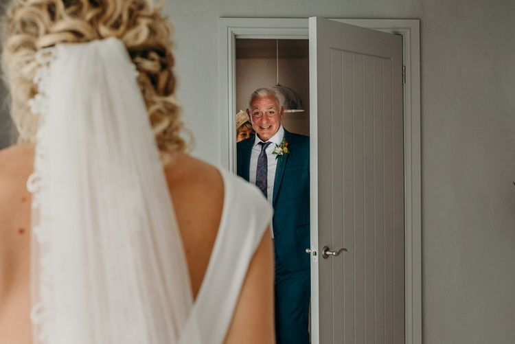 Bride's father sees her for the first time in wedding dress