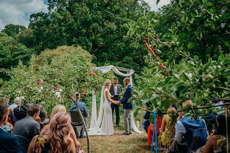 Outdoor ceremony with bright wedding decorations
