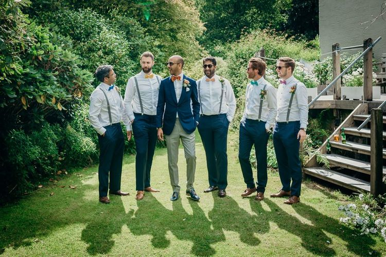 Groomsmen in matching outfits and colourful bowties