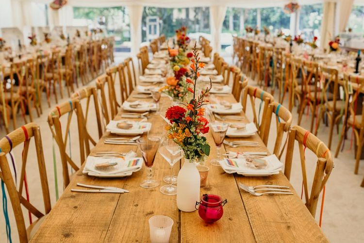 Beautiful bright wedding decorations with colourful flowers for tables