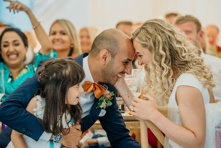 Bride and groom steal a moment during wedding reception
