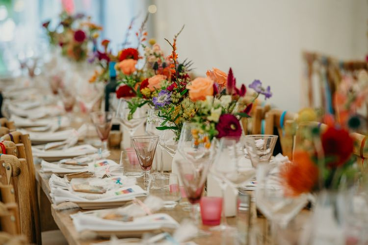 Bright wedding decorations for dinner tables in marquee