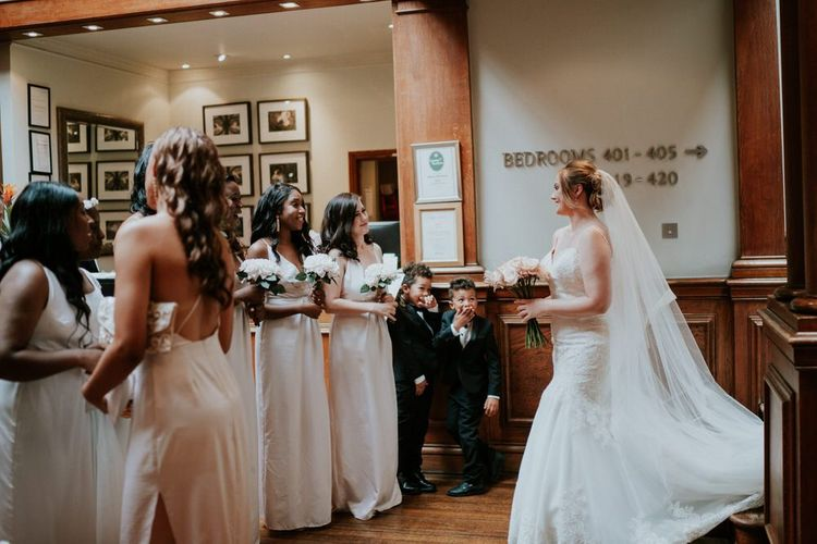 Bridal party first look with bride in Morilee wedding dress