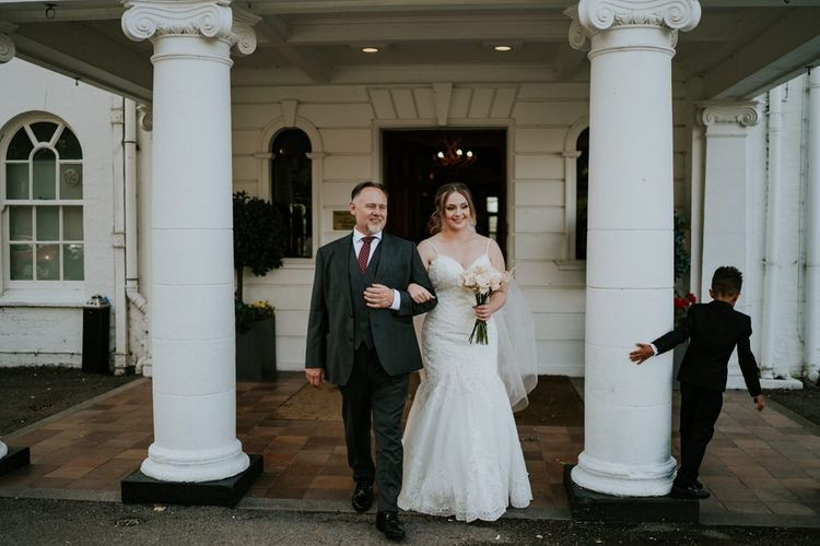 Father of the bride and daughter  in Morilee wedding dress and