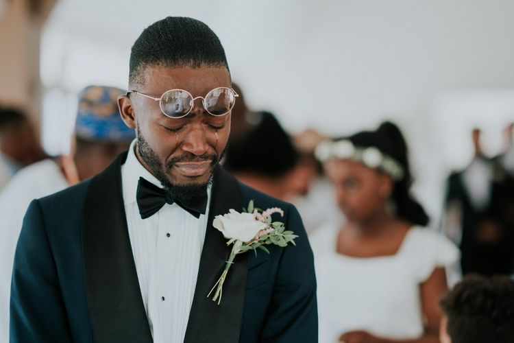 Tearful groom as his bride enters the wedding ceremony