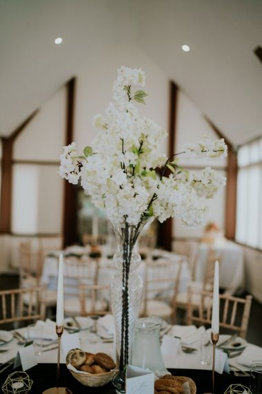 Tall white blossom floral centrepiece