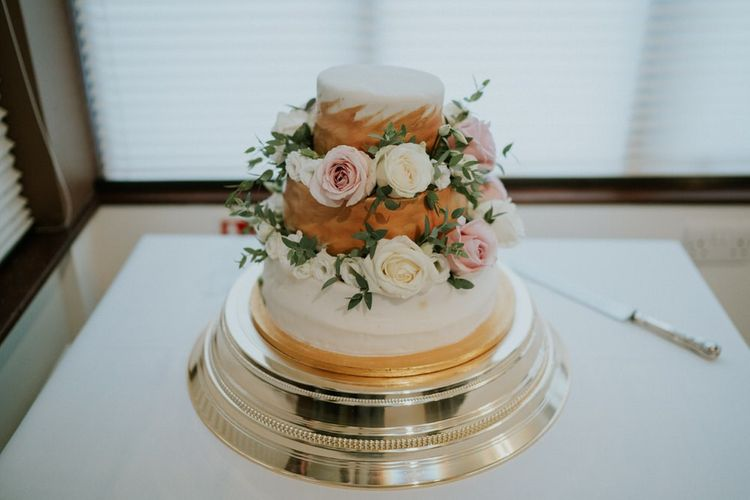 Three tier wedding cake decorated with flowers