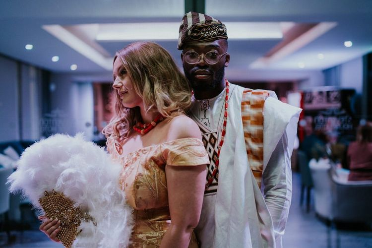 Bride and groom in traditional Nigerian Yoruba outfits