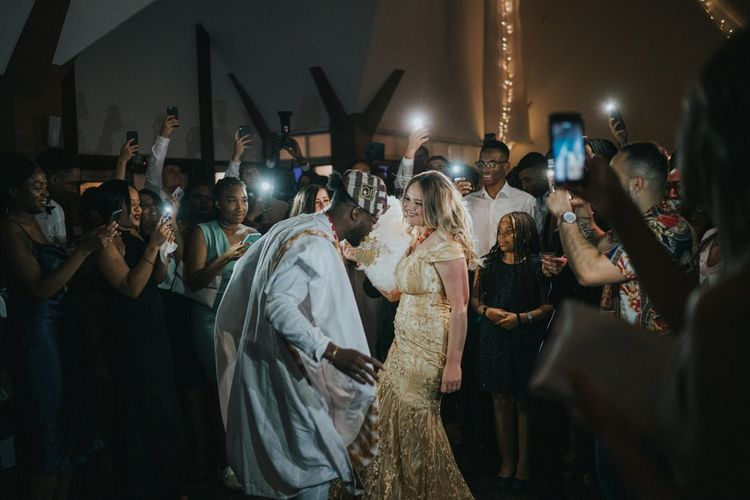Bride and groom on the dance floor in Nigerian Yoruba outfits