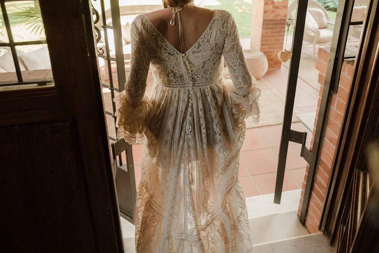 Bride in Bell sleeve wedding dress
