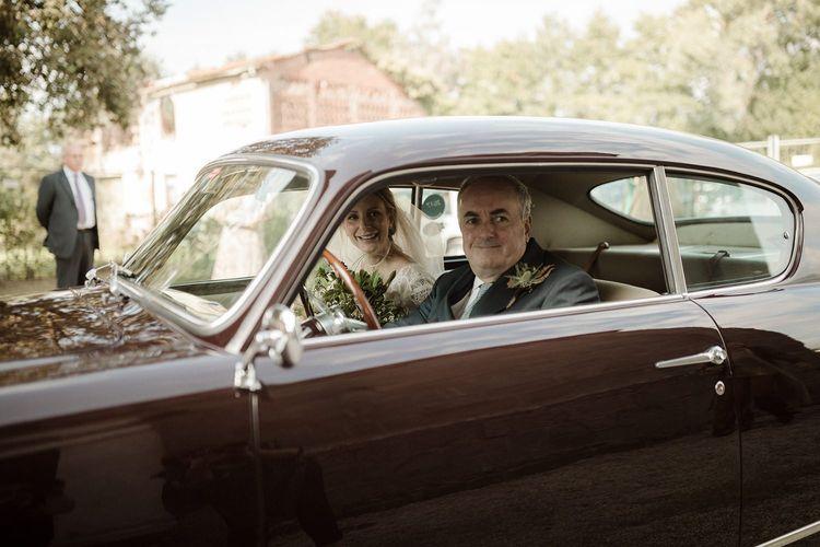 Bride in vintage wedding car